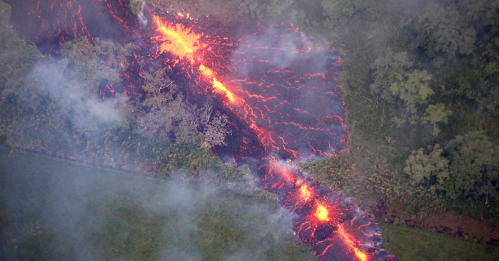 Lava erupts from a fissure east of the Leilani Estates subdivision during ongoing eruptions of the Kilauea Volcano